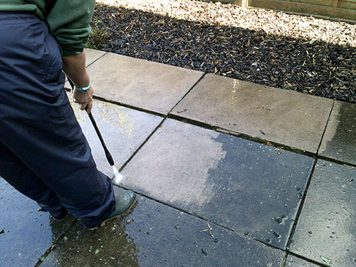 Pressure washing of hard surfaces